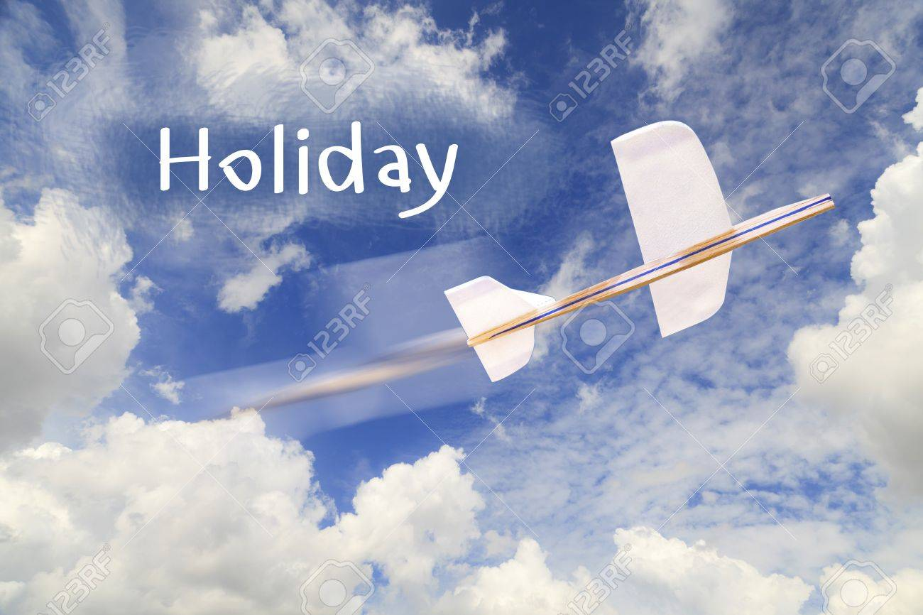 Airplane model on blue sky and Holiday text Stock Photo - 19185557