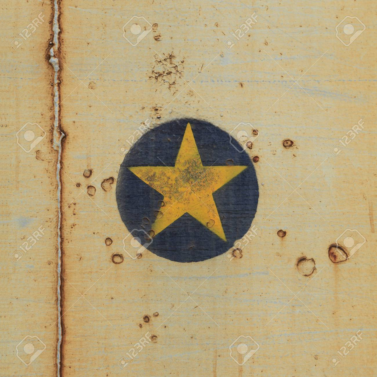 Yellow star on old steel background Stock Photo - 19793300