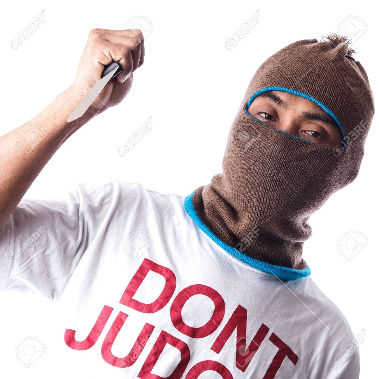 Man in a mask holding knife Stock Photo - 25081494