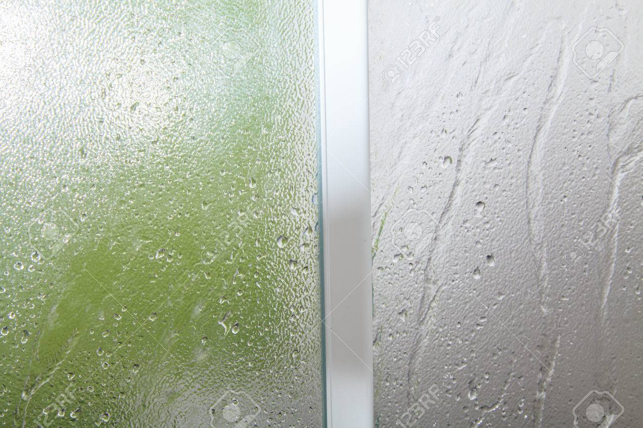 Glass Texture Background On Shower Room In Bathroom With Water Drops Stock Photo