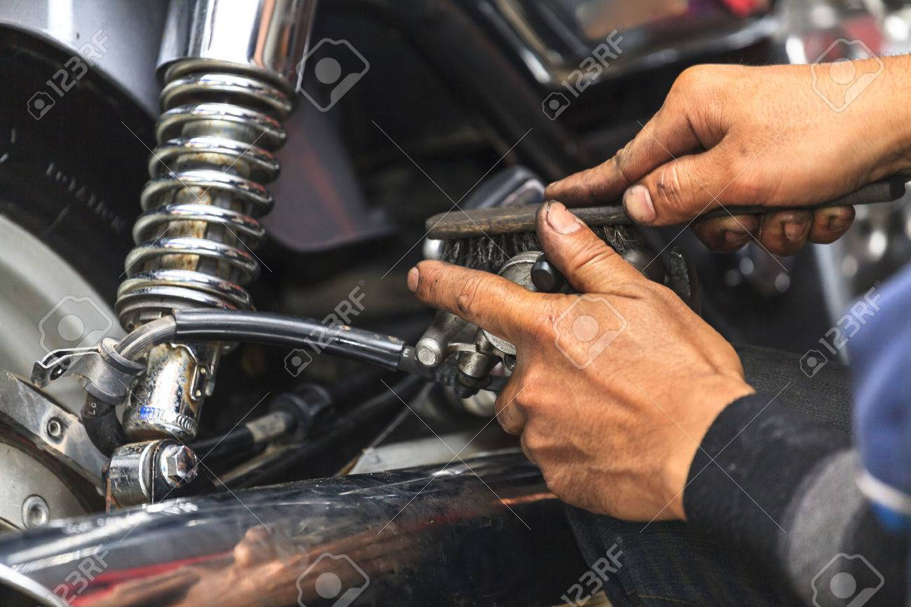 cropped view of motorcycle mechanictechnician stock photo 52980597