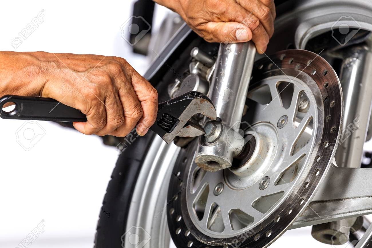 cropped view of motorcycle mechanic on white background stock photo 90619322