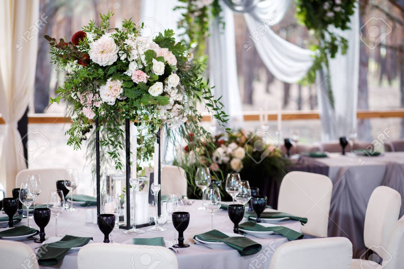 Festive wedding table setting with flowers, napkins, cutlery, glasses and candles, bright summer table decor. - 143539883