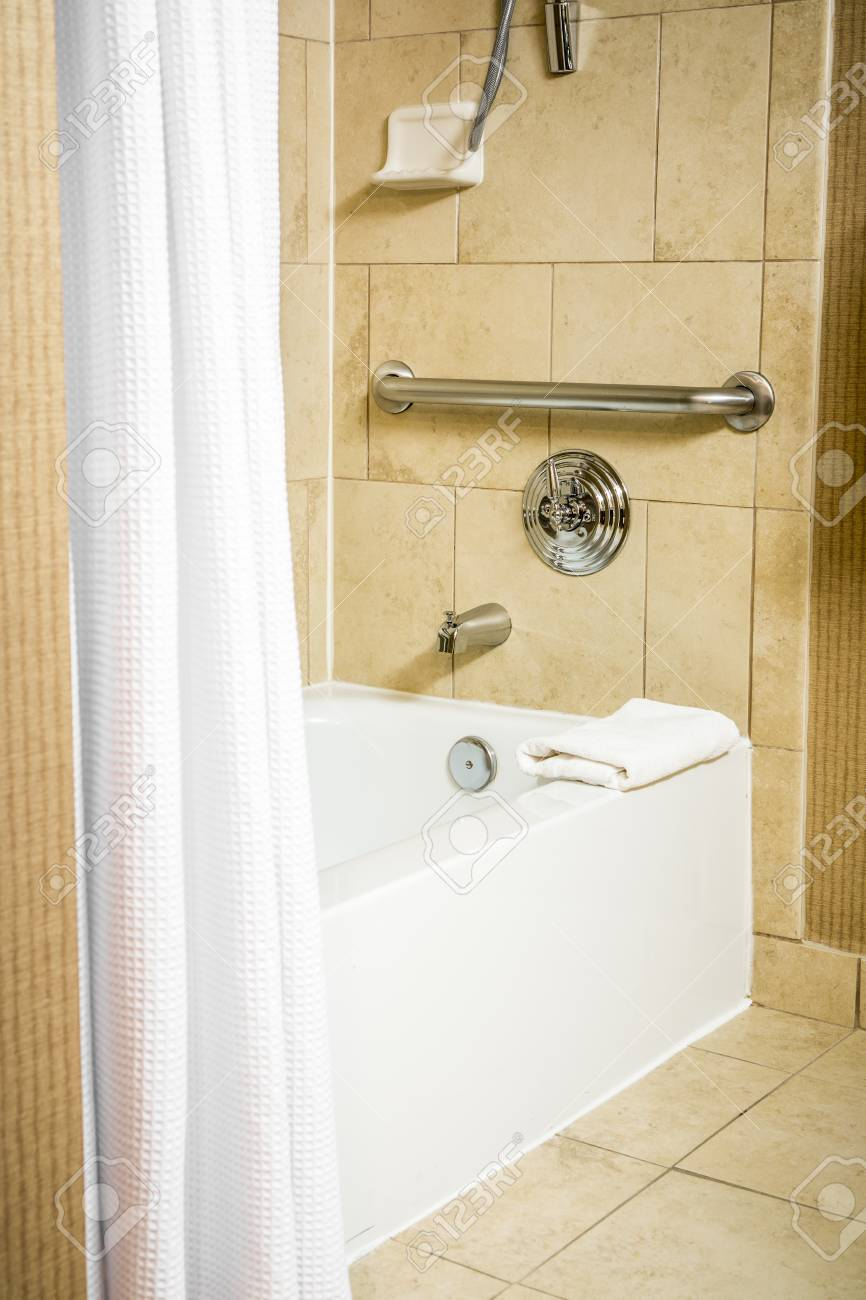 Handicapped Accessible Bathtub In A Hotel Room With Grab Bar.. Stock ...