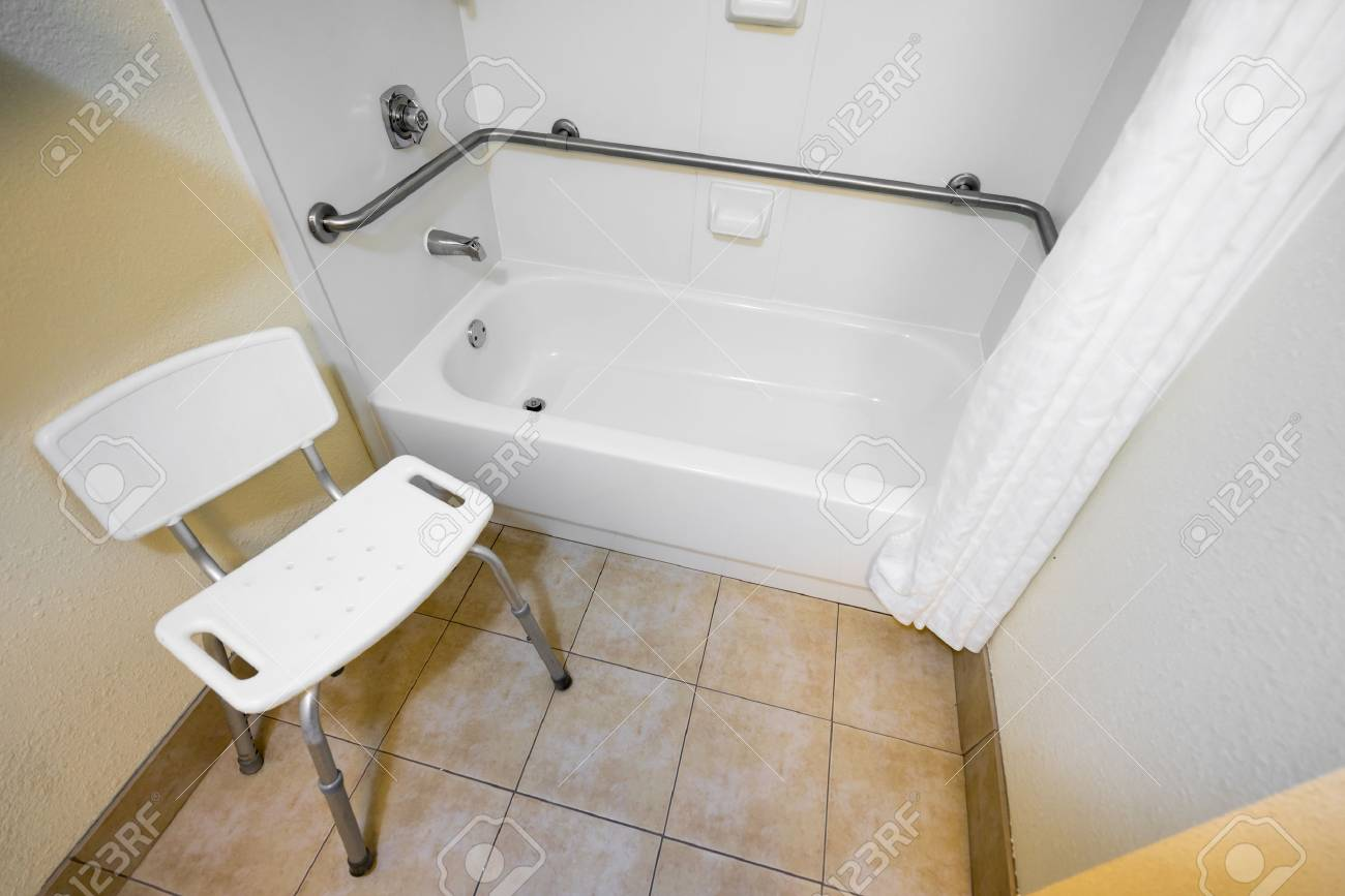Disabled Access Bathtub And Chair In A Hotel Stock Photo, Picture ...