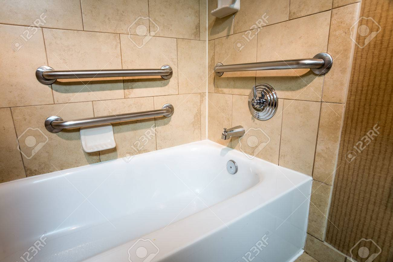 Handicapped Access Bathtub In A Hotel Room With Grab Bar Hand