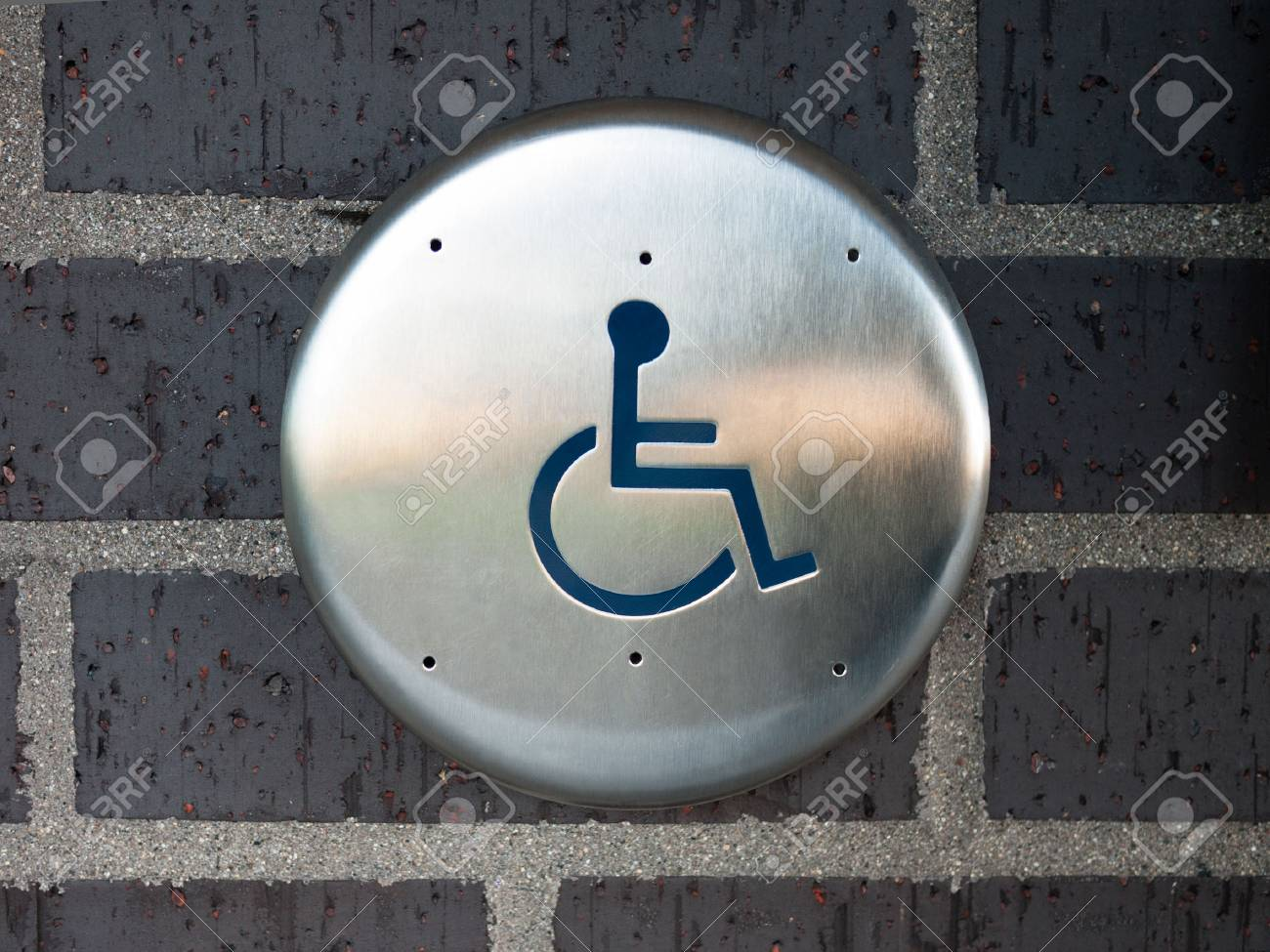 Handicapped automatic door opener button switch on a brick wall Stock Photo - 77879007 & Handicapped Automatic Door Opener Button Switch On A Brick Wall ...
