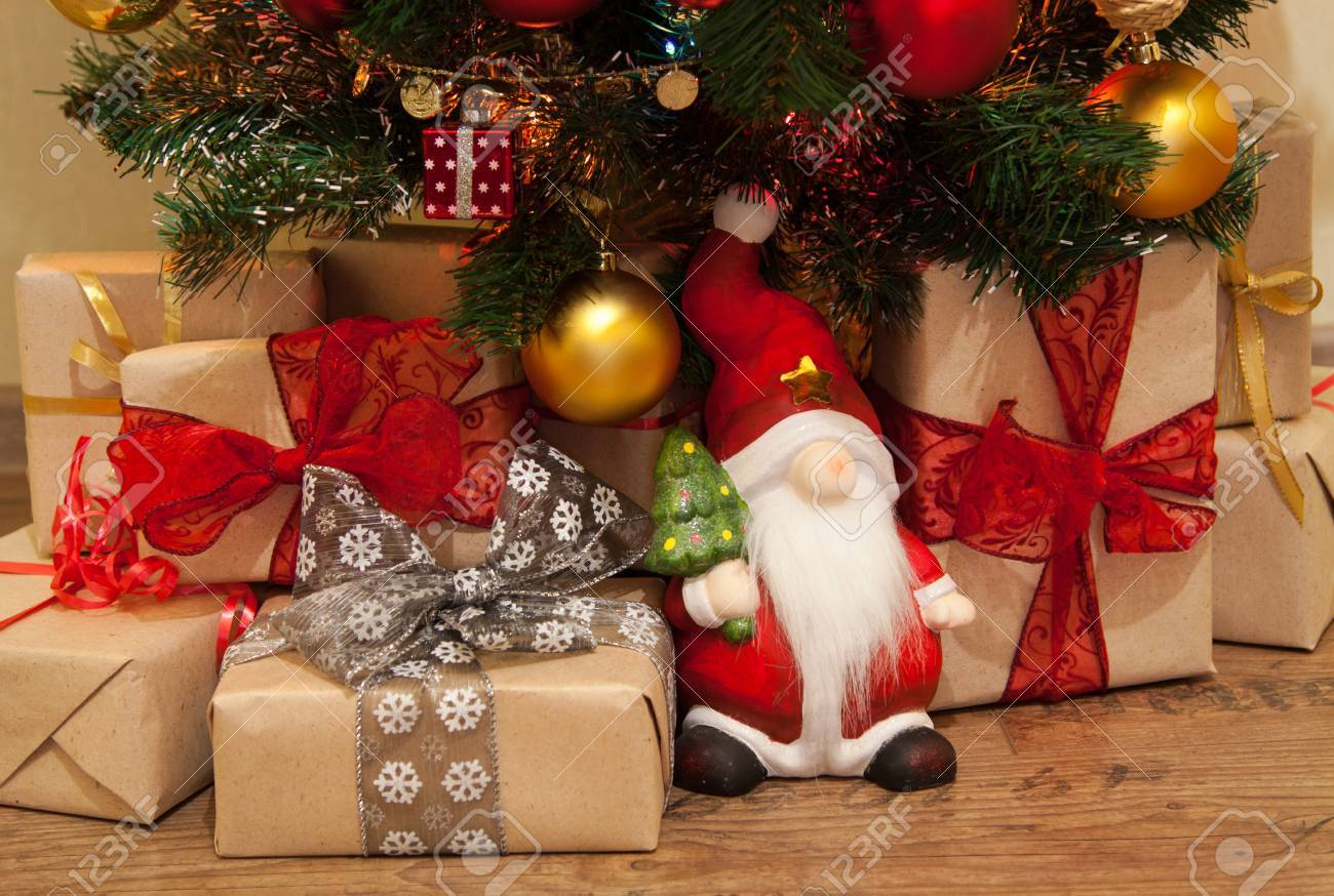 Santa With Christmas Presents Under The Tree Stock Photo, Picture ...
