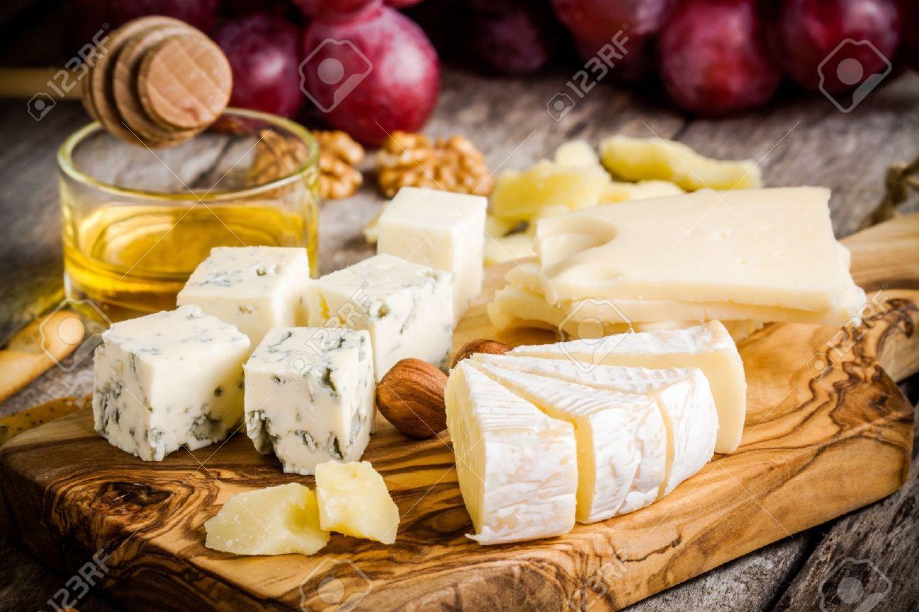 Cheese plateEmmental Camembert Parmesan blue cheese bread sticks walnuts & Cheese Plate:Emmental Camembert Parmesan Blue Cheese Bread ...