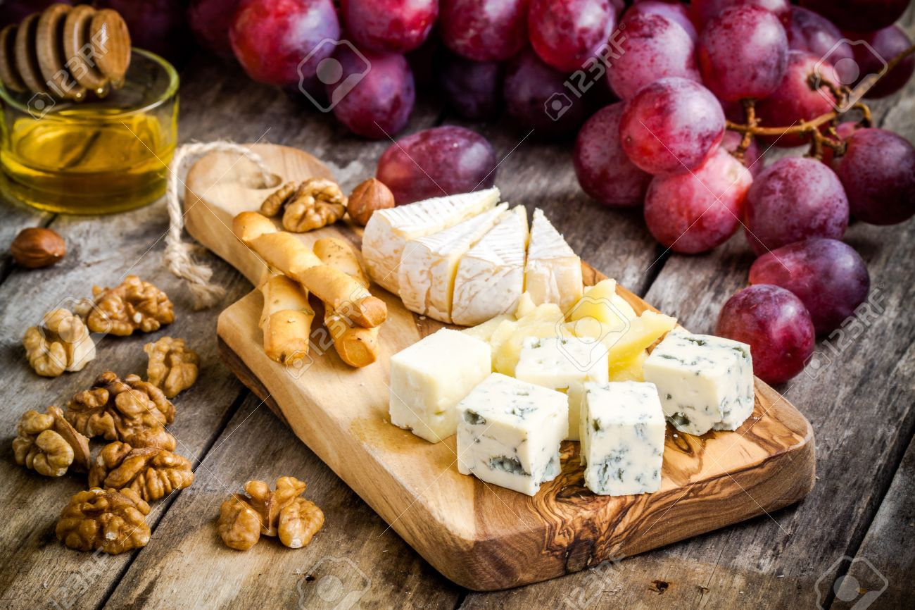 Cheese plate Camembert Parmesan blue cheese bread sticks walnuts hazelnuts & Cheese Plate: Camembert Parmesan Blue Cheese Bread Sticks ...