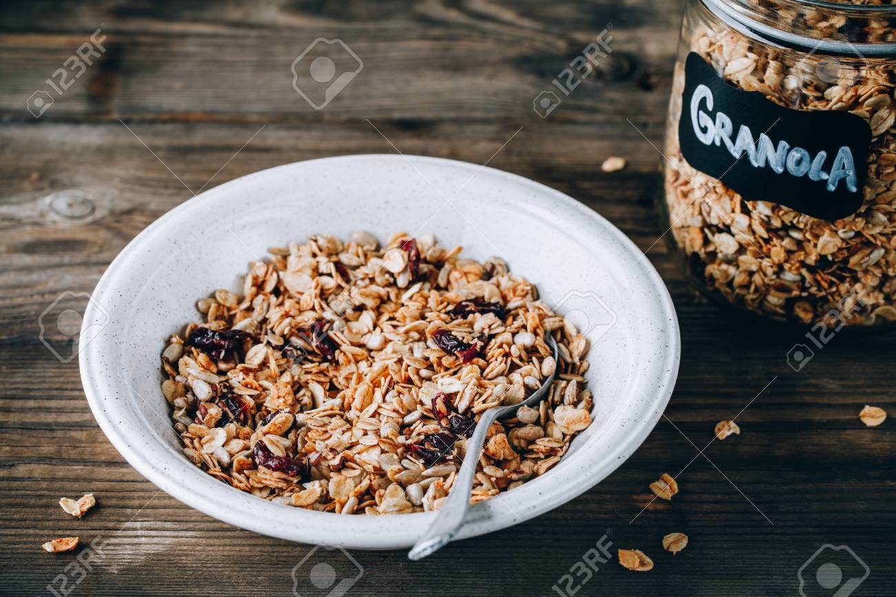 Organic homemade granola cereal with oats and nuts and dry cranberries. Healthy breakfast. Stock