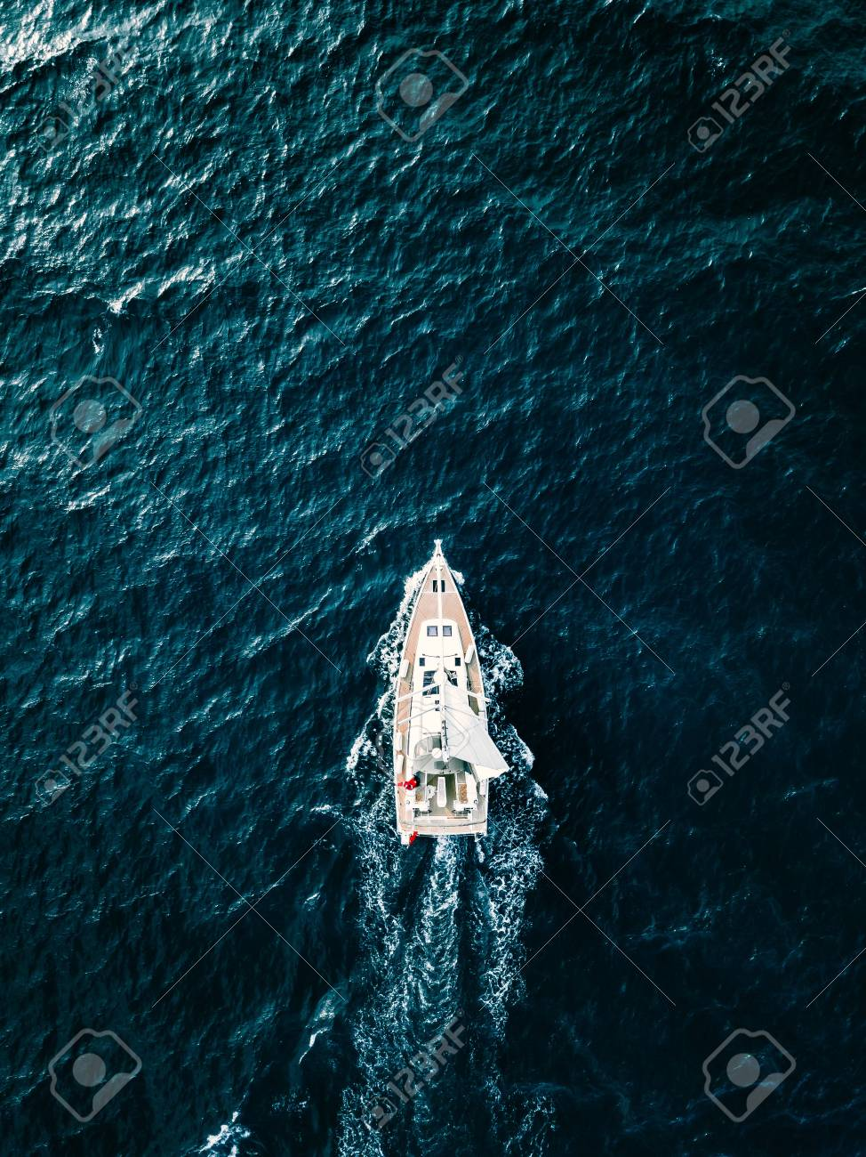 Aerial view of Sailing ship yachts with white sails in windy condition in deep blue sea - 120633157