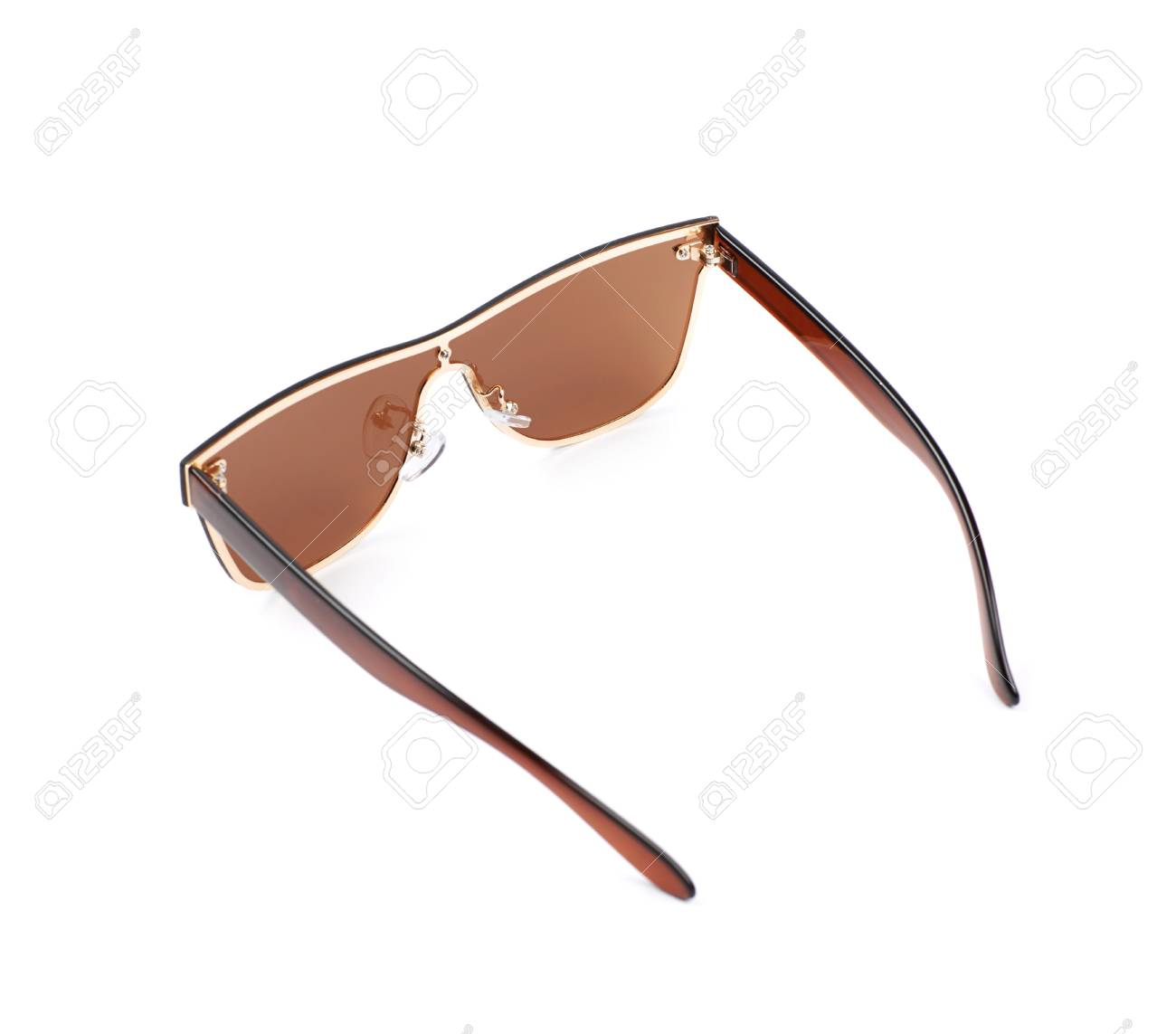 be1414b9978 Pair of brown shade sunglasses isolated over the white background Stock  Photo - 59653185