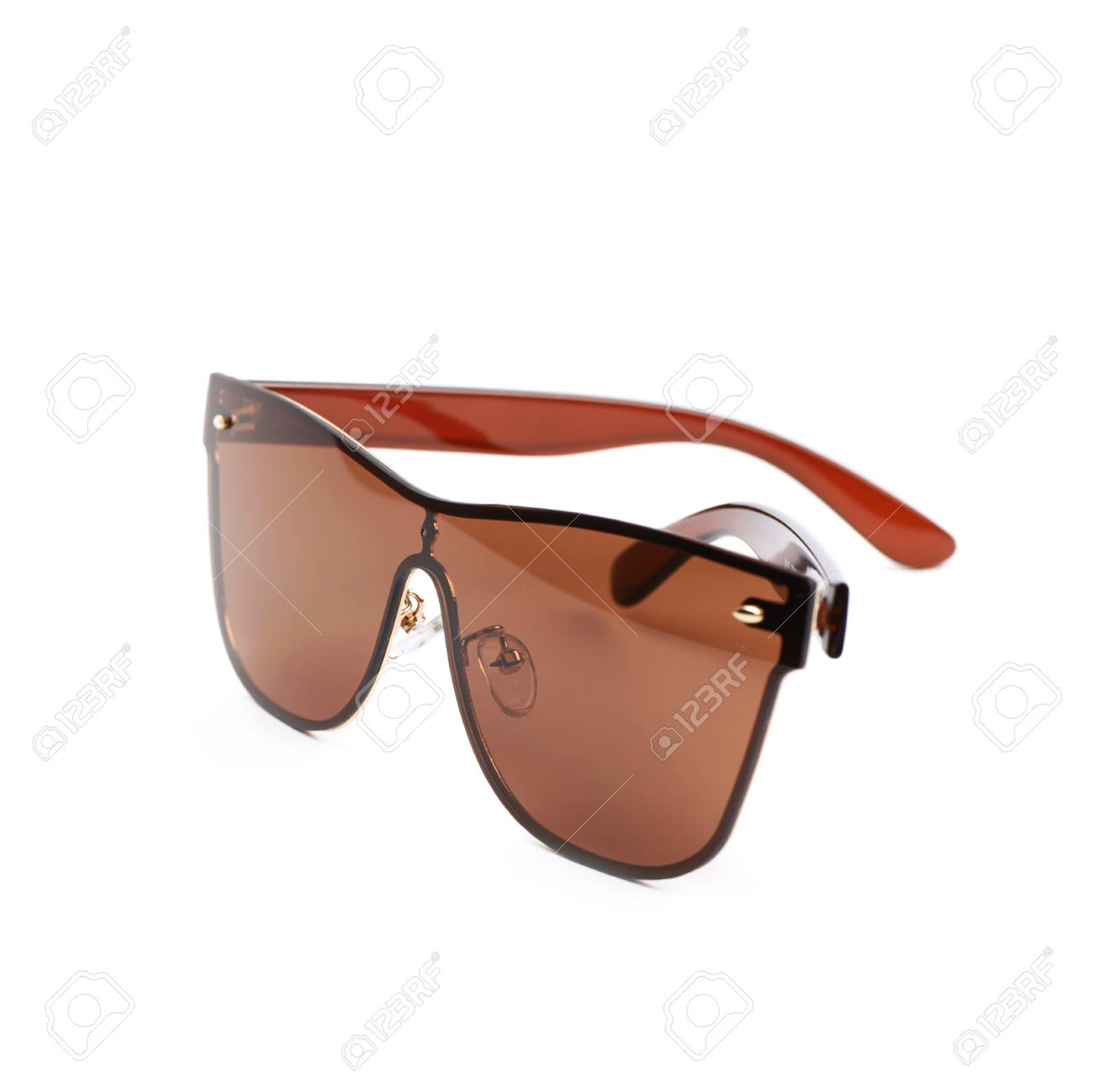9540cb9a88b Pair of brown shade sunglasses isolated over the white background Stock  Photo - 60707507