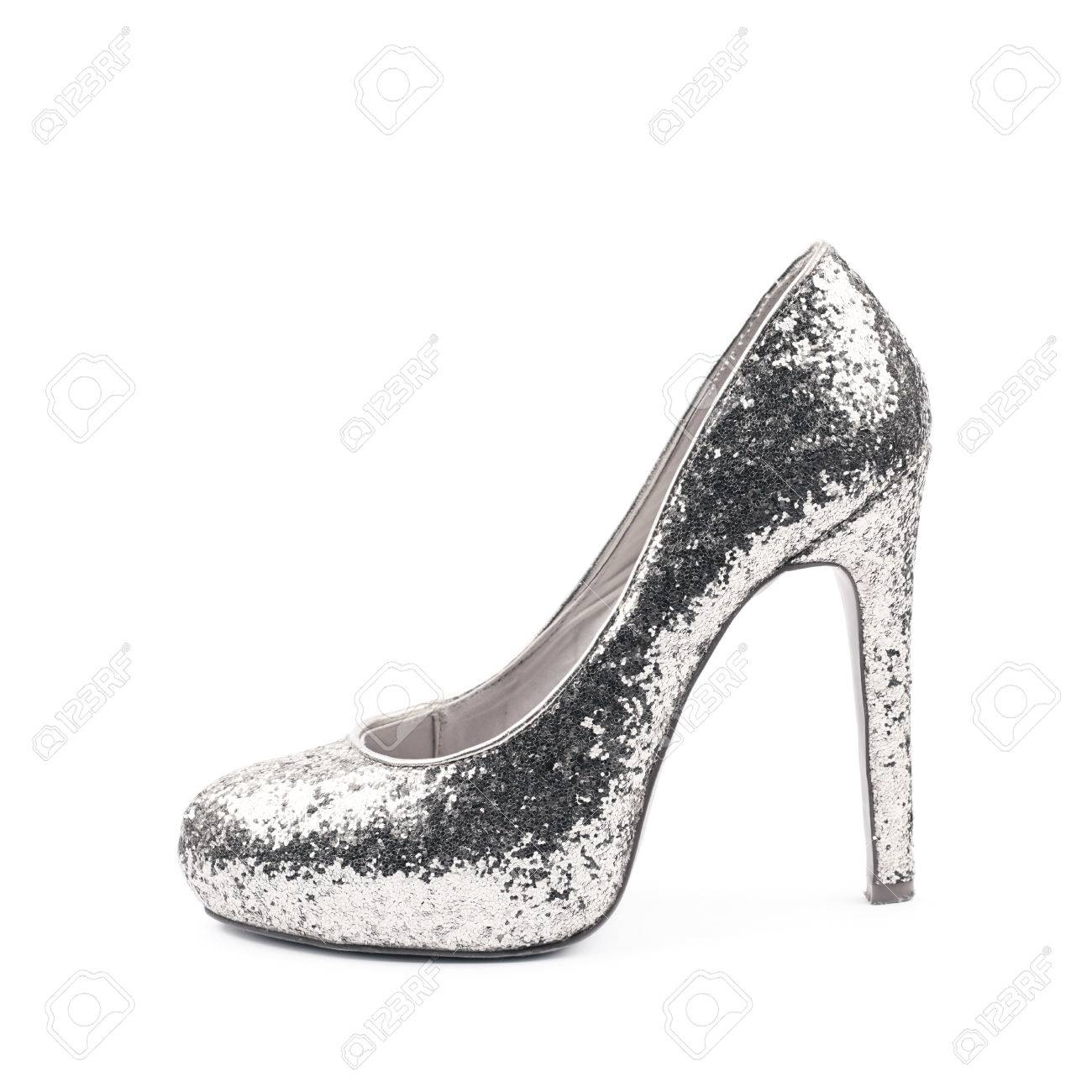 ba57540686c Shining silver high-heeled footwear shoe isolated over the white background  Stock Photo - 60706924