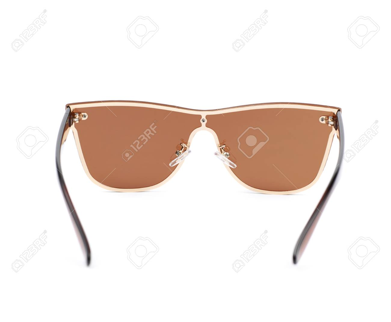 bc5df23b053 Pair of brown shade sunglasses isolated over the white background Stock  Photo - 61261408