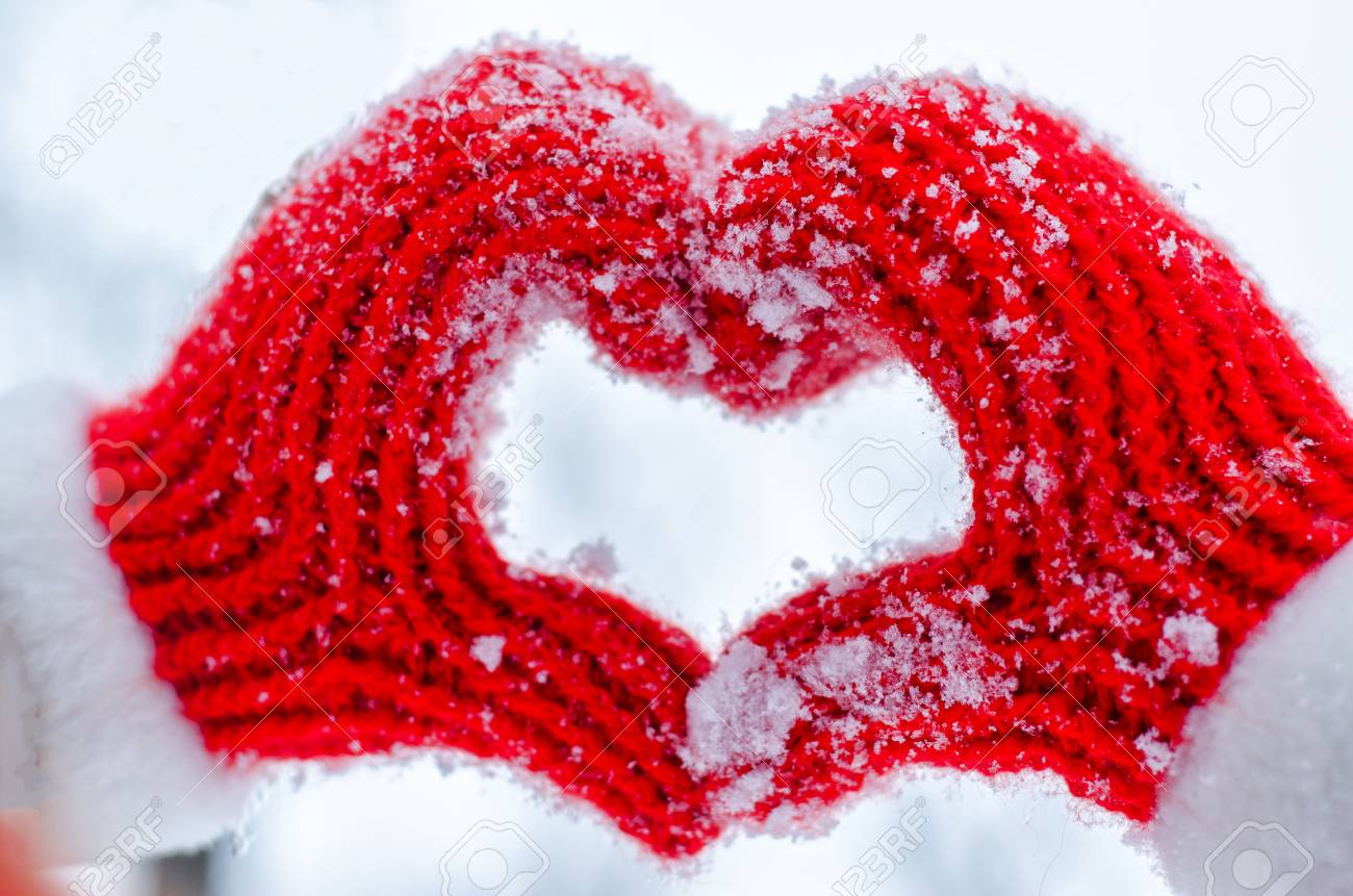 Knitted red mittens show the symbol of love stock photo picture knitted red mittens show the symbol of love stock photo 86497788 biocorpaavc Images