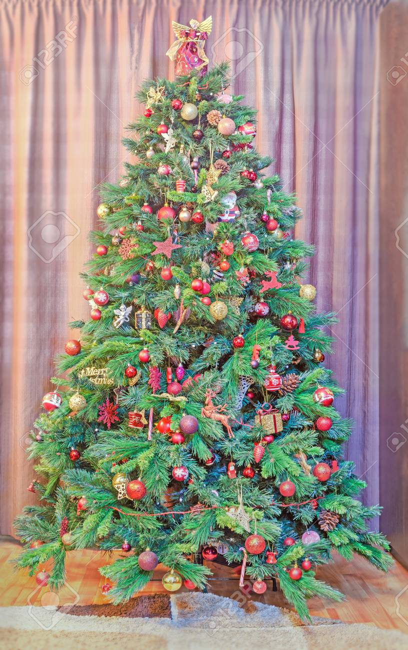 Green Christmas Tree With Many Vibrant Colored Ornaments Colored Stock Photo Picture And Royalty Free Image Image 71328670