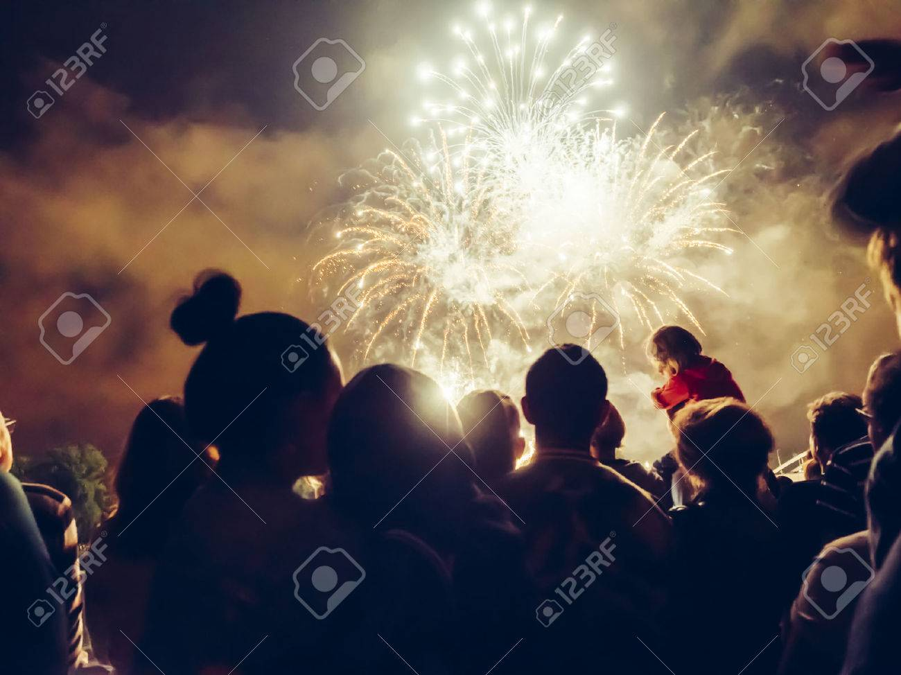 Crowd wathcing fireworks and celebrating Stock Photo - 44067025