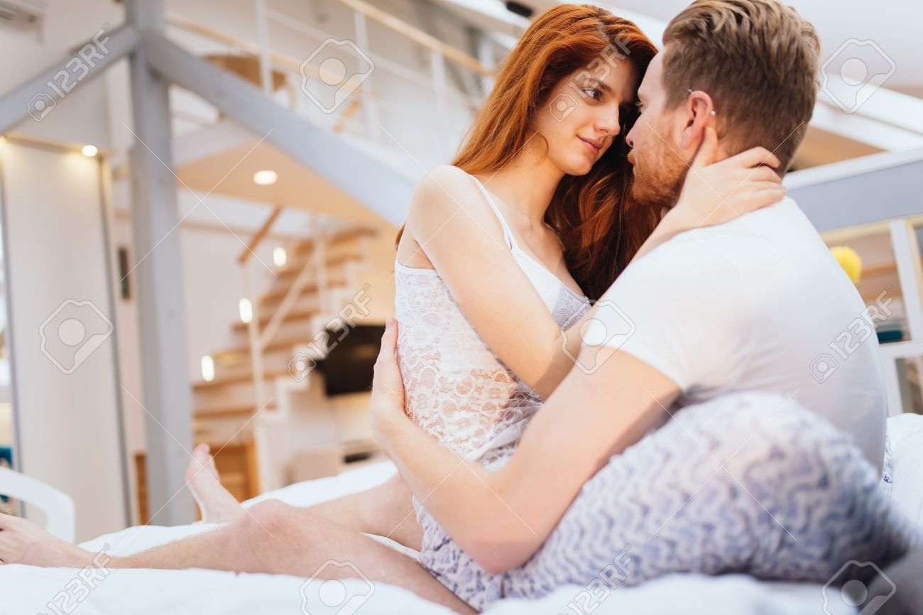 Romantic couple in love lying on bed and being passionate Stock Photo    53463250. Romantic Couple In Love Lying On Bed And Being Passionate Stock