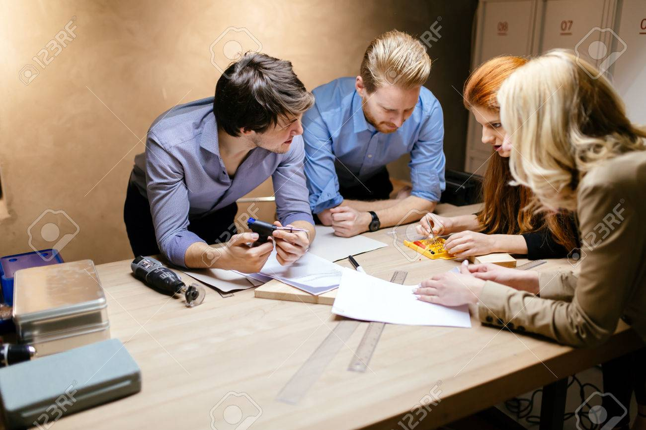 Group of designer working on project in workshop - 57623786