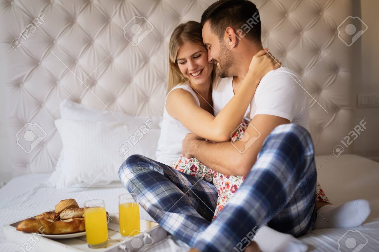 Romantic Loving Couple In Morning Bed Stock Photo