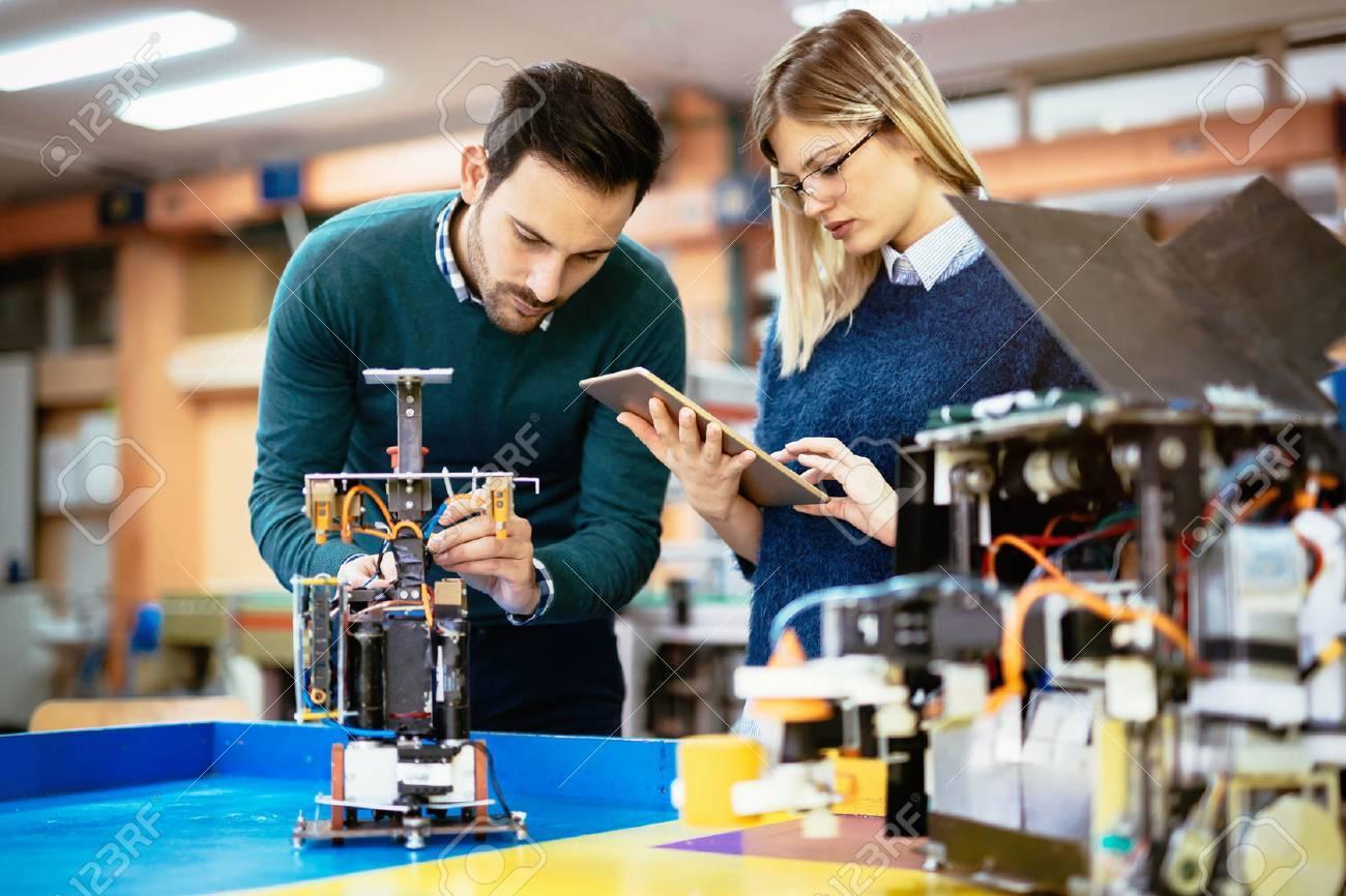 Robotics engineer students teamwork on project - 65803582