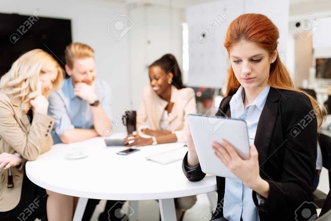 Business People Board Meeting In Modern Office While Sitting At Round Table  Stock Photo   67424960