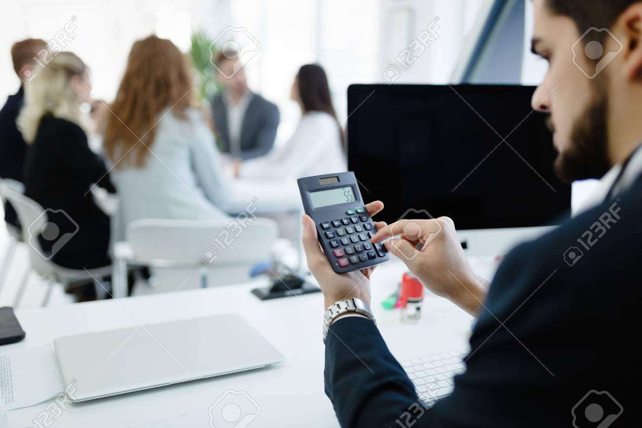 Accountant Checking Statistics Of Company Profit On Calculator ...