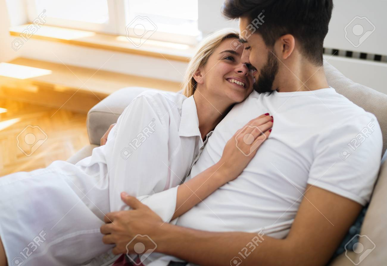 Cute Couple Hugging And Smiling In Their Home Stock Photo Picture And Royalty Free Image Image 80996291