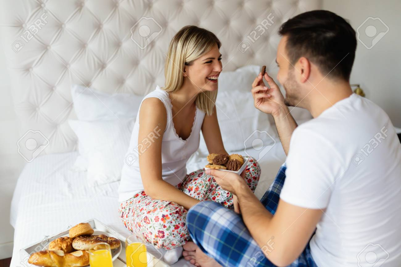 Romantic Husband Waking Wife With Breakfast In Bed Stock Photo
