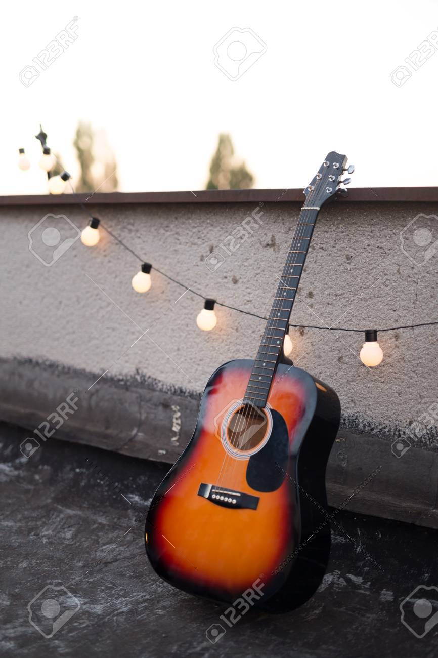 Picture Of Nice Accoustic Guitar On Rooftop Stock Photo Picture And
