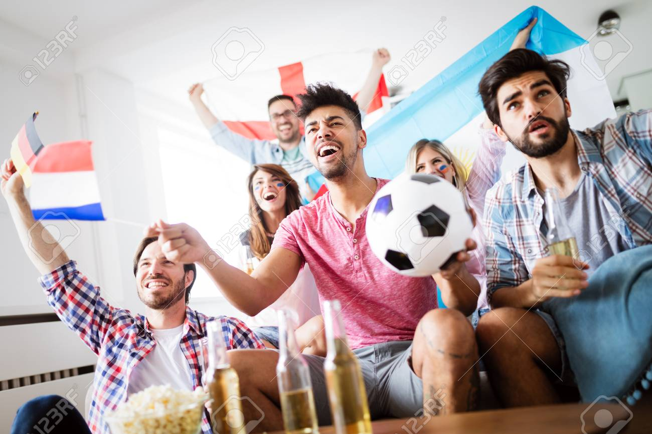 Friends watching football game at home - 101076516