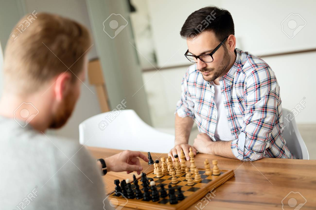 two young man playing chess at home stock photo picture and royalty rh 123rf com chest at home exercise chase at home employee login