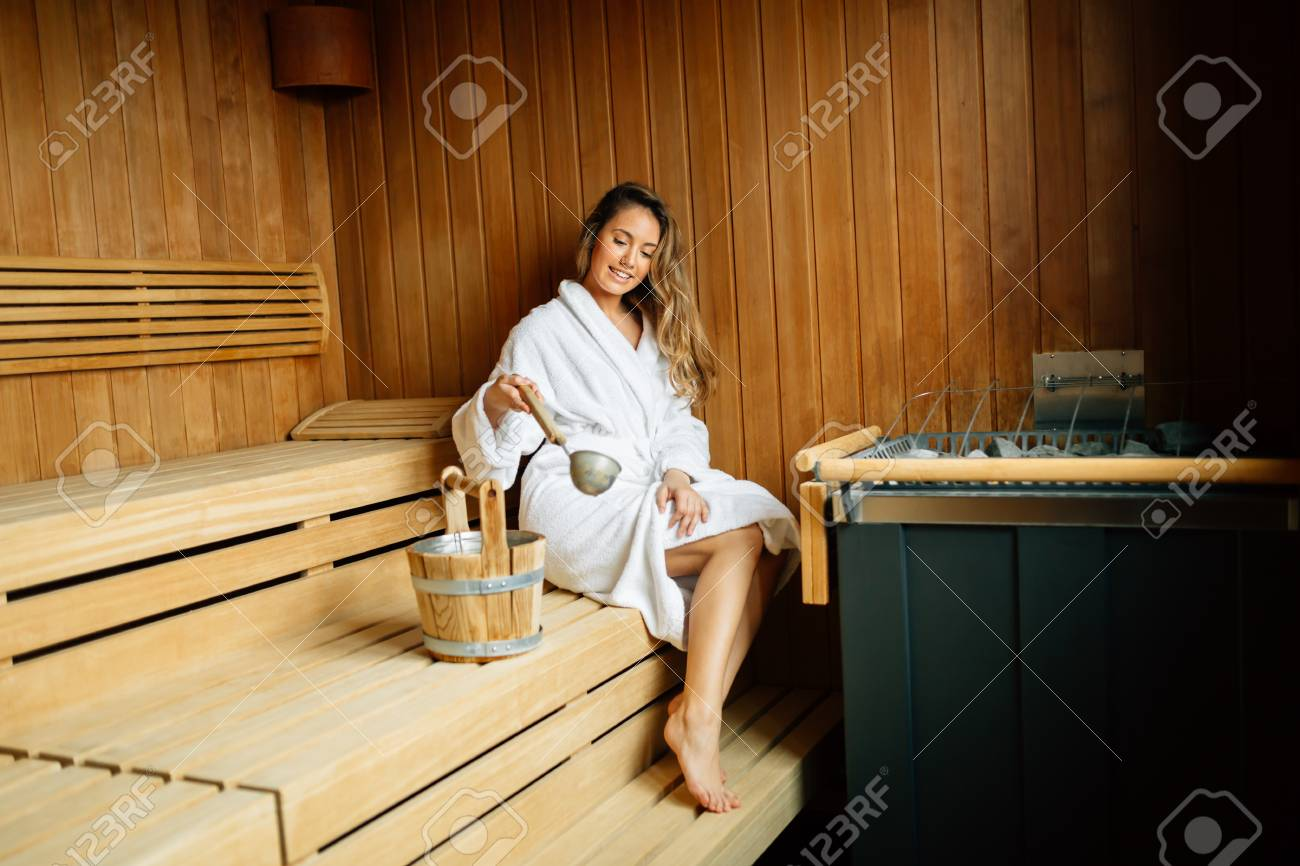 Beautiful woman in finnish sauna - 110109817