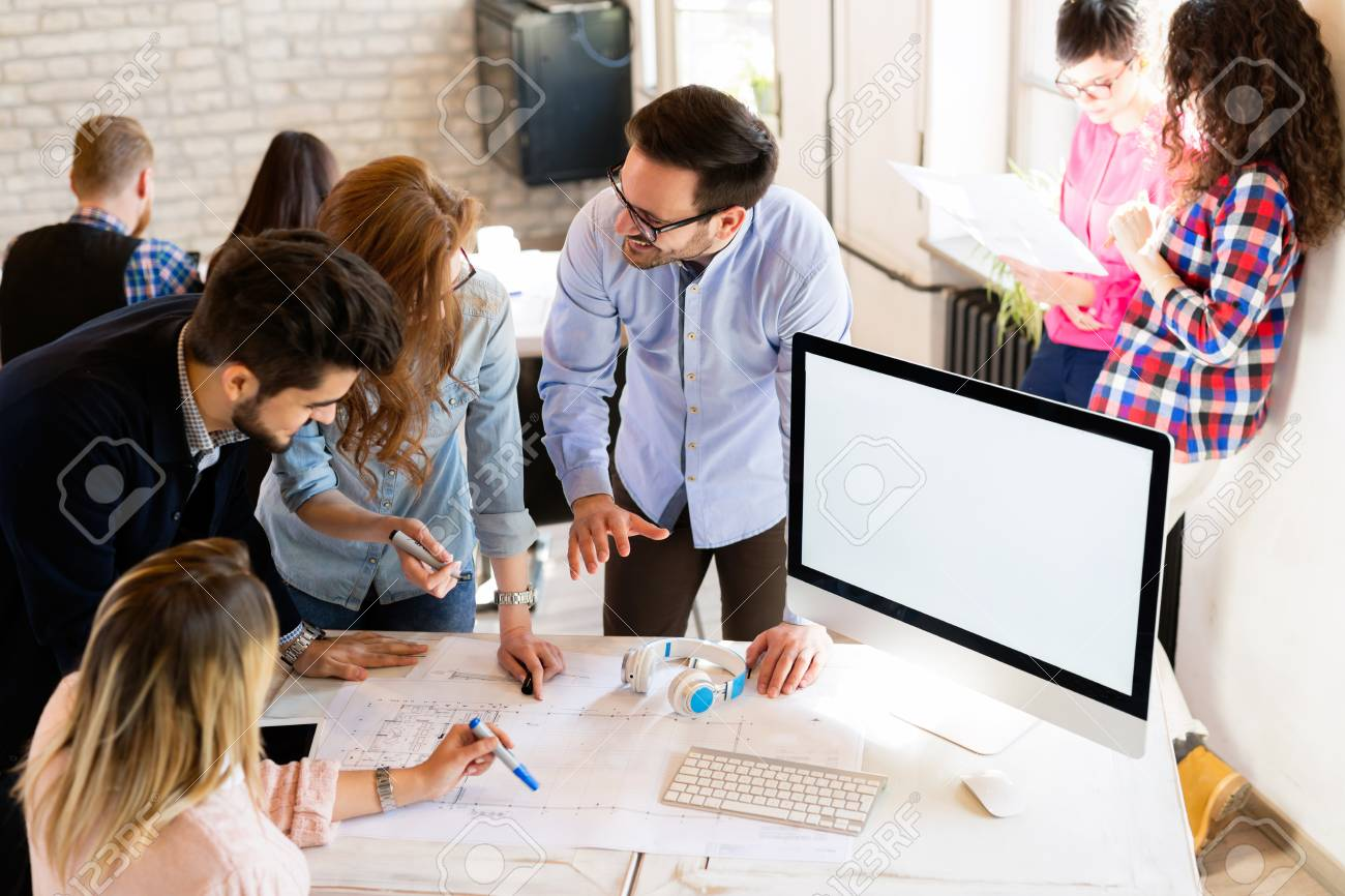 Picture of young architects discussing in office - 111195116