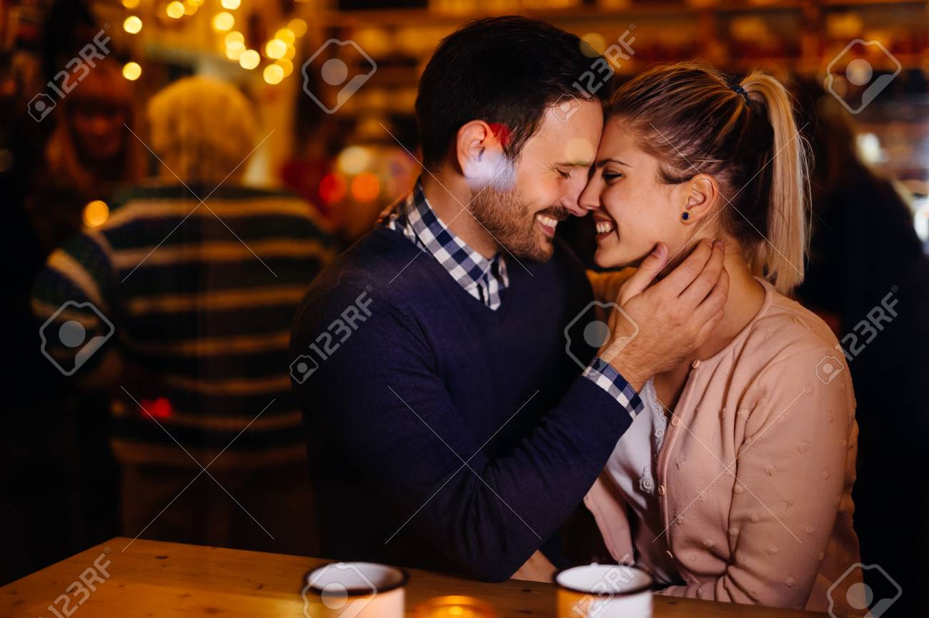 Romantic couple dating in pub at night - 112906411