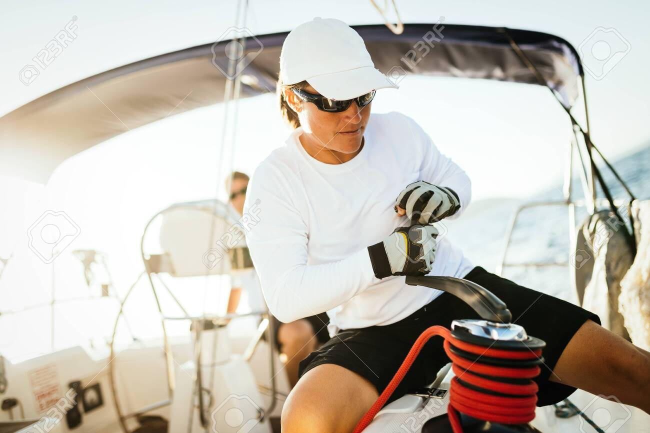 Attractive strong woman sailing with her boat - 120427219