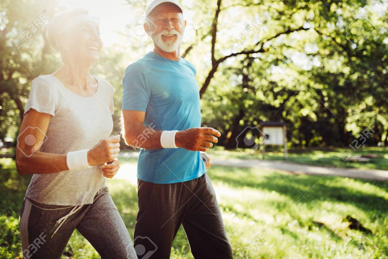 Happy senior people jogging to stay helathy and lose weight - 120492845