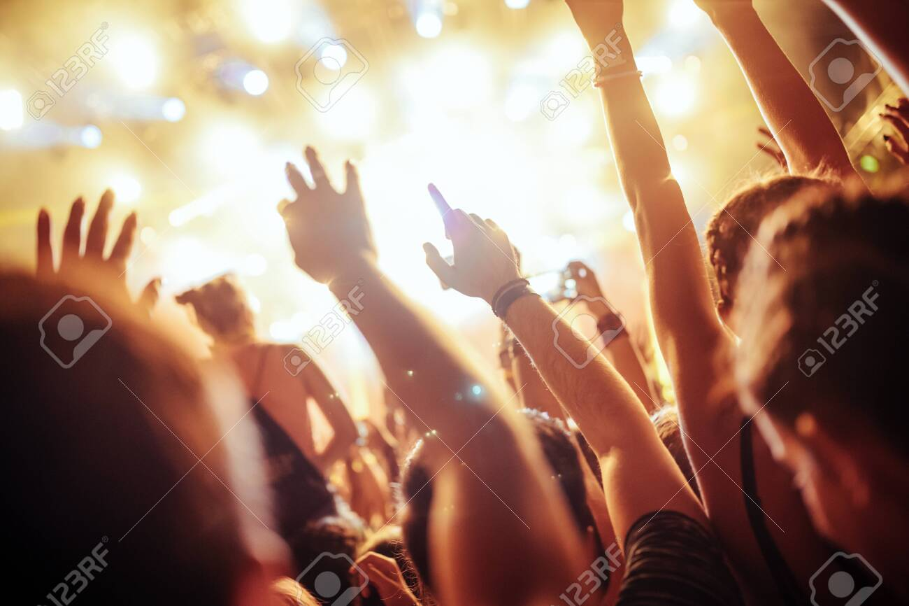 Portrait of happy crowd enjoying at music festival - 122744544