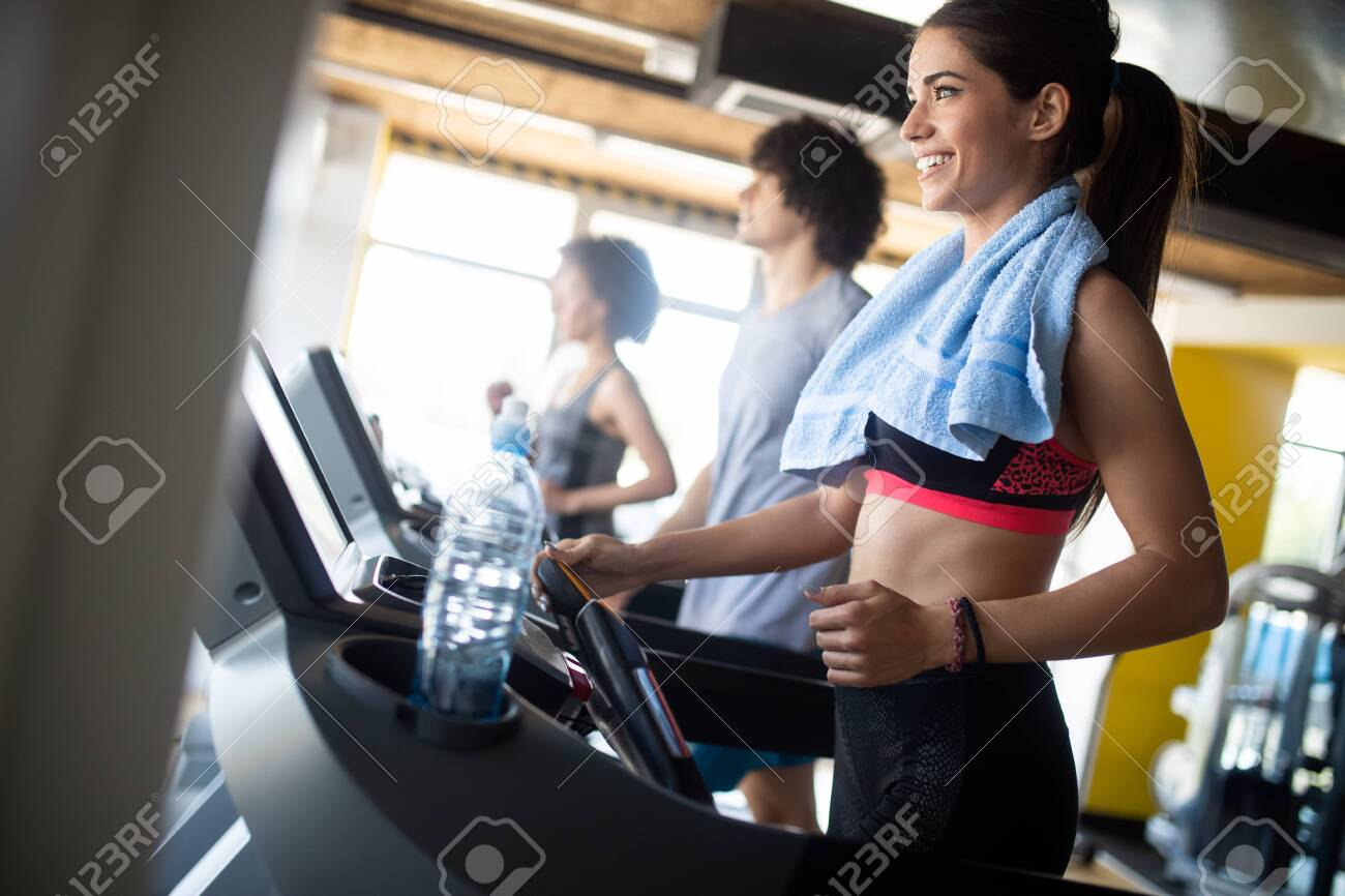 Group of sportive people in a gym. Concepts about lifestyle and sport in a fitness club - 123584582