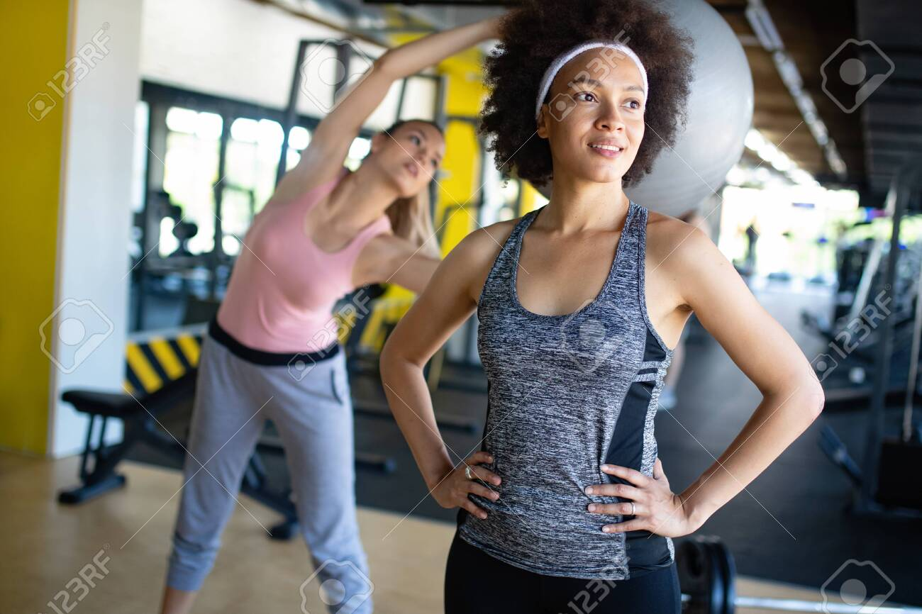Beautiful Fit Women Exercising Together In Gym Stock Photo Picture And Royalty Free Image Image 129272886 They think if they pick up some real weight that they'll wake up the next morning looking like a linebacker in the nfl. 123rf com