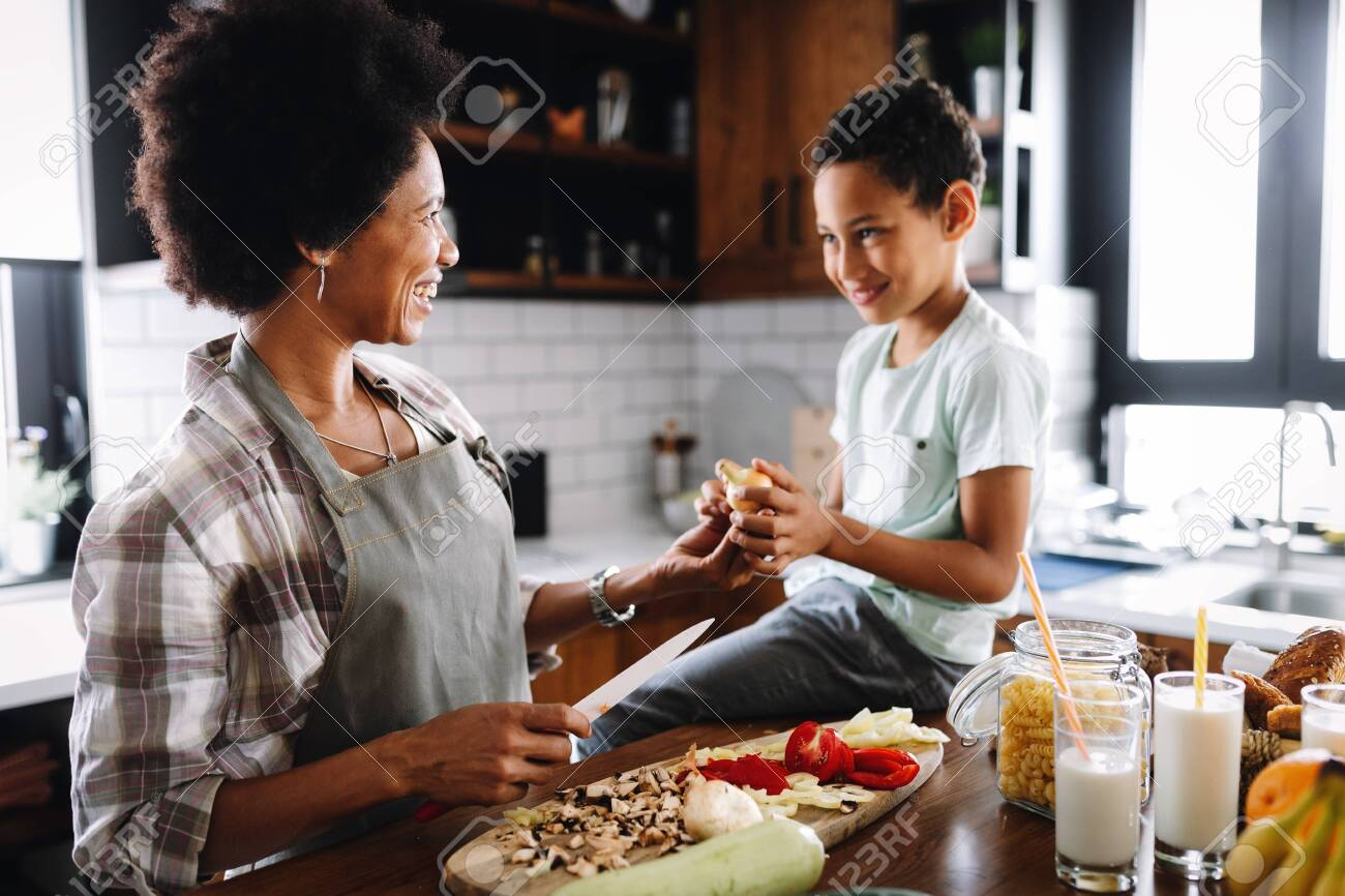 Mother and child having fun preparing healthy food in kitchen - 133831875