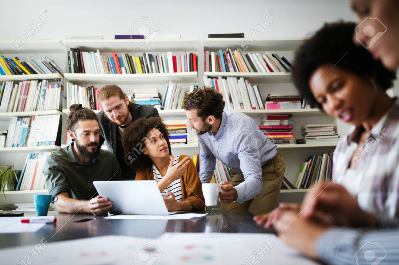 Group of business people collaborating on project in office - 139945360