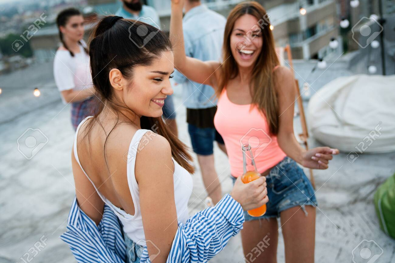 Having a great time with friends, having fun at rooftop party - 147403824