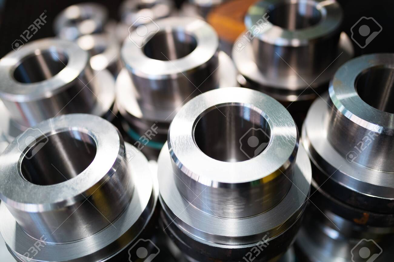 Industrial background from metal parts produced in metal industry - 152360498