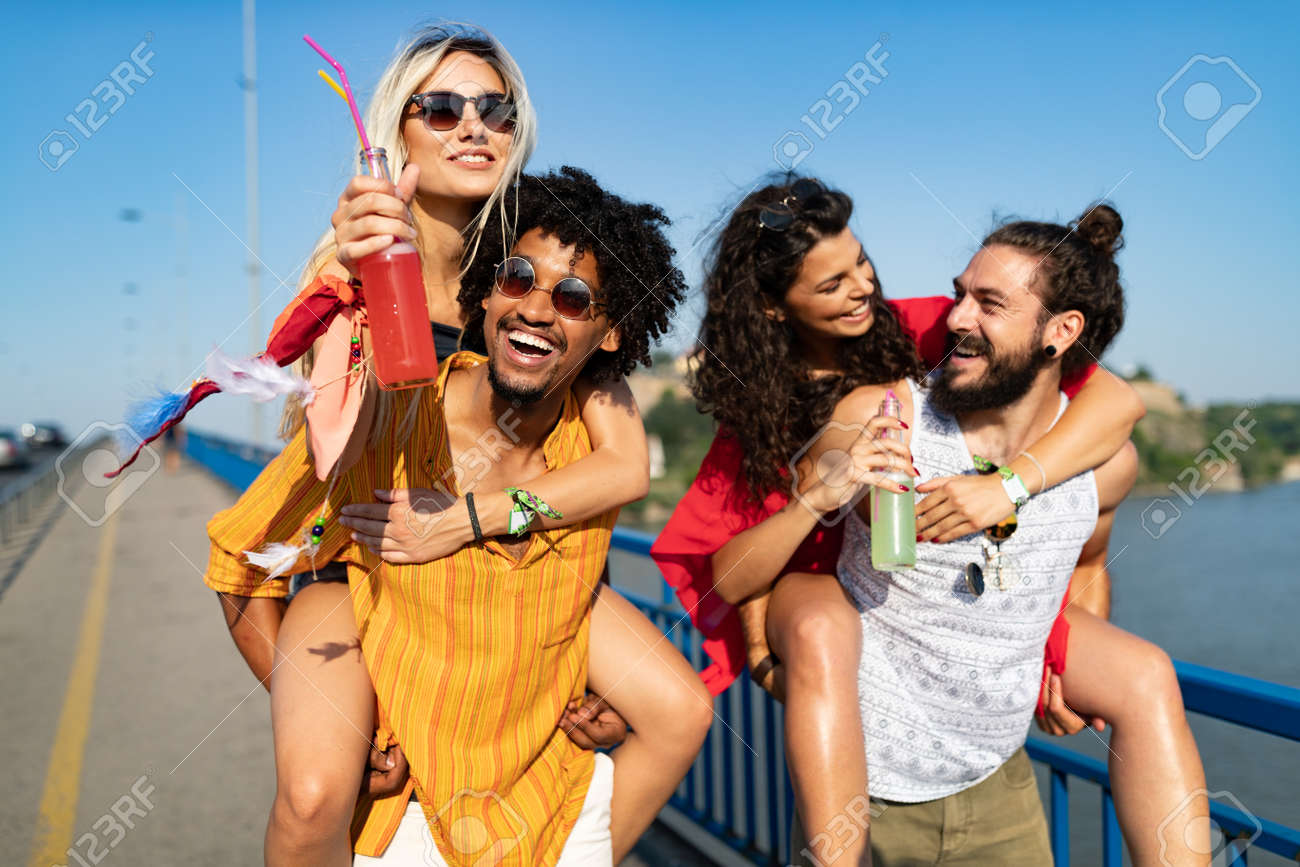 Group of happy friends people having fun together outdoors - 155360919
