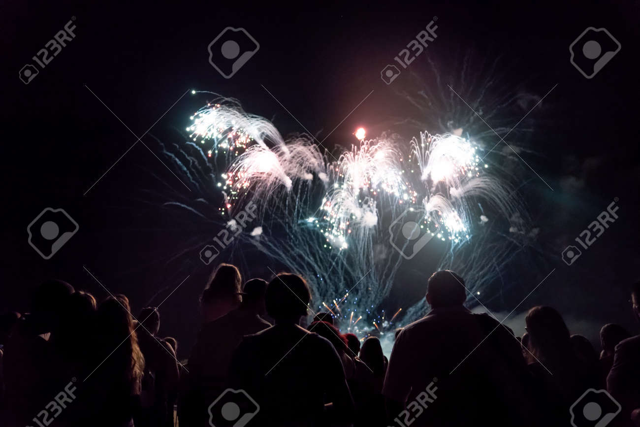 Crowd watching fireworks and celebrating new year eve - 159120901