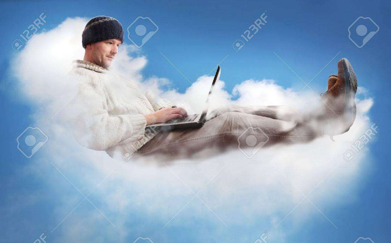 A man on a cloud operating a laptop.  The man is dressed casually to represent the majority of IT workers.  The concept is Cloud Computing - software/computing in the cloud. Stock Photo - 12376149