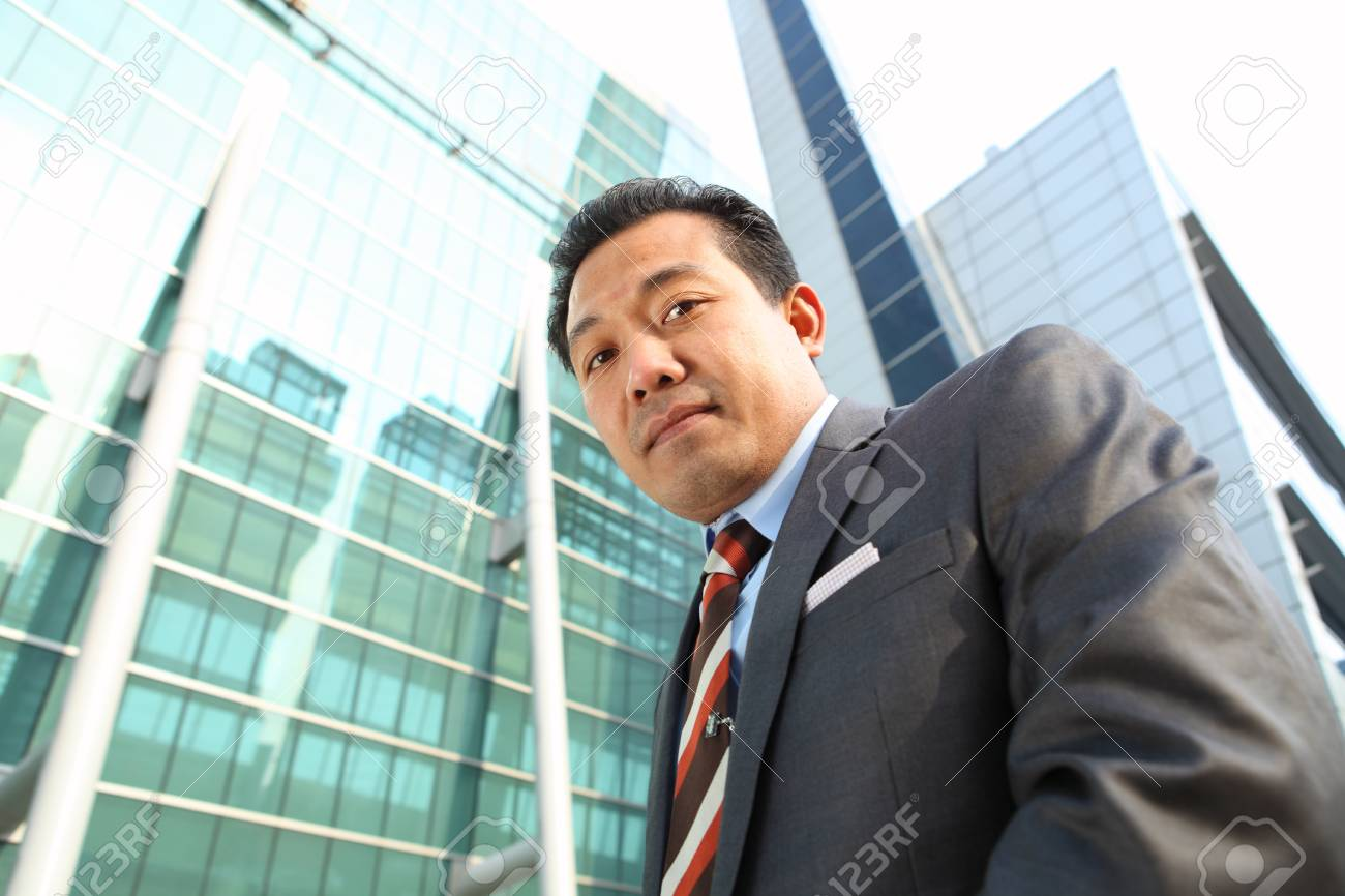 businessman front office modern building Stock Photo - 15290506